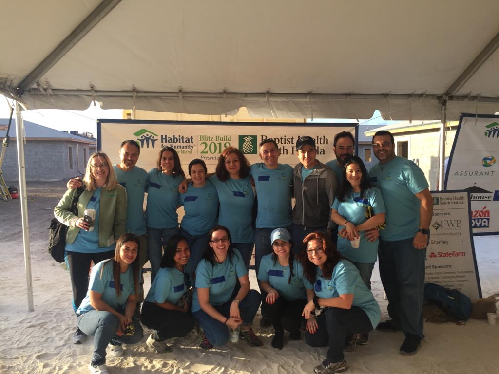 CV Credit posing for the habitat for humanity picture
